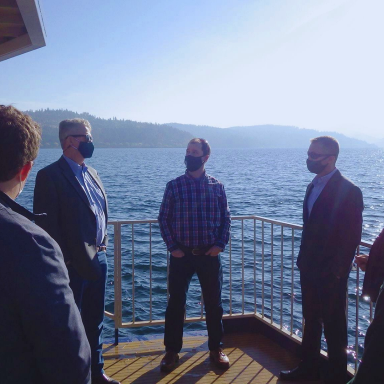 Govenor Little and DEQ Director Byrne in a boat on the Coeur d'Alene Lake.